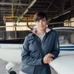 Female Pilot In Hangar